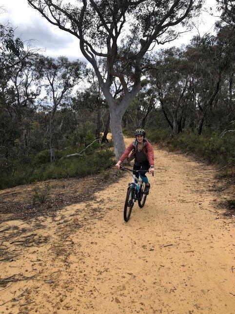 Mountain biking along the trail to Hanging Rock